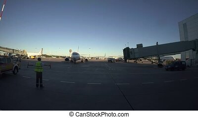 Manager at the airport makes parking the aircraft. 4K. -...
