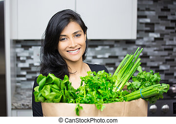 Green veggies - Closeup portrait, young woman with bag full...
