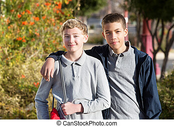 Friend with arm around schoolmate - Handsome teen with arm...