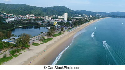 Aerial view of beautiful tropical blue sea and long beach...
