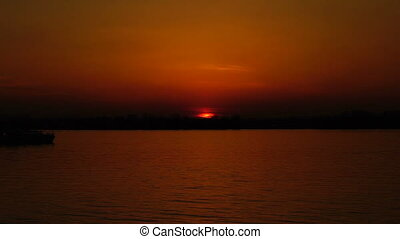 ship sails on the river at sunset background. - ship sails...