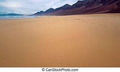 Flight over desert beach on Fuerteventura island, Spain -...