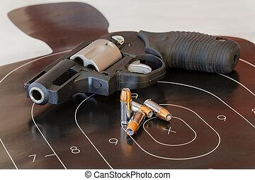 Gun Ammunition And Target - Ammunition on a target