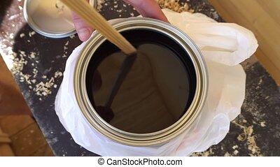 mixing nail Polish on wood stick.