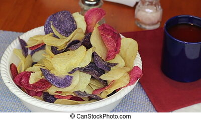 Fingers Choosing Colorful Potato Chips - Male fingers...