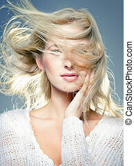 blowing hair - close up portrait of young blonde, with...
