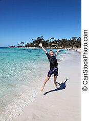 Boy at Binalong Bay - Bay of Fires - Tasmania Australia