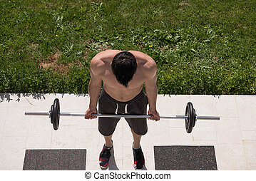 man doing morning exercises - young handsome man doing...