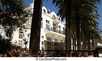 A huge white multi-storey estate in palm trees. Herceg Novi,...