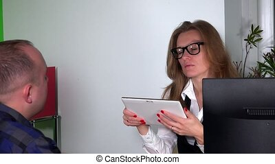 Designer architect woman make notes of client wishes on tablet computer