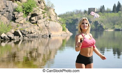 Portrait of glamor young woman making selfie. mountain river...