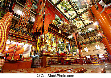 Buddha inside temple in old building at day