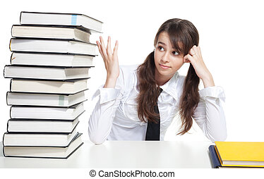 Study hard - Sad school girl sitting with pile of books
