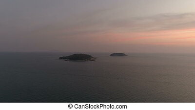 Aerial video of two small island during sunset