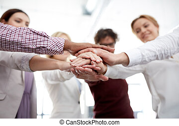 happy business team with hands on top at office - business,...