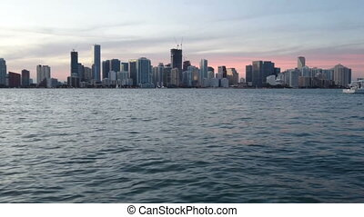 Downtown Miami seen from a boat navigating at the sunset