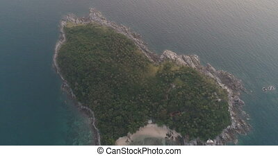 Aerial video of heart shaped small island during sunset -...