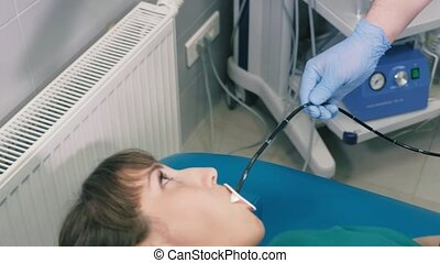 Doctor makes a gastroscopy young girl through the mouth 4k -...