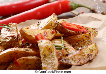 Fried potatoes on baking paper rustic serving