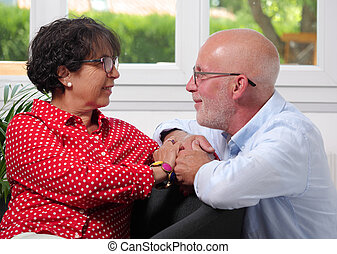 Happy senior couple in love at home