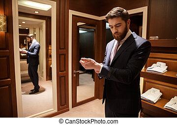 Man in formalwear standing in wardrobe - Handsome man in...