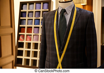 Photo of men suit jackets on hanger - Photo of checkered men...