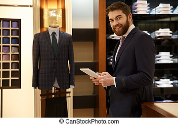 Cheerful man in suit with tablet in wood room - Bearded...