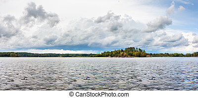 Ladoga lake under cloudy sky in overcast day - Natural...