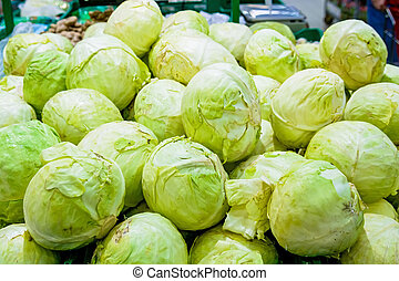 Green cabbage heads in supermarket - Close up green cabbage...