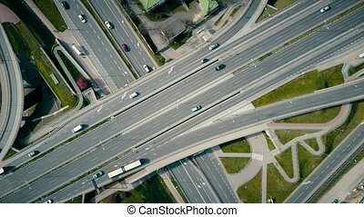 Aerial rising shot of big urban road junction, top down...
