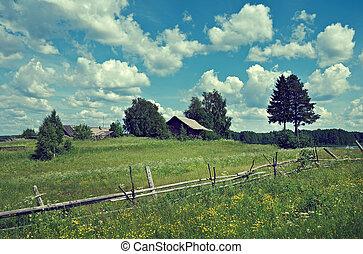 Russian summer meadow. Wooden fence. Arkhangelsk region,...
