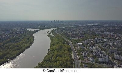 Aerial shot of Vistula river and Warsaw cityscape on a sunny...