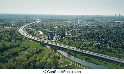 Aerial shot of a highway curve near Warsaw, Poland. - Aerial...