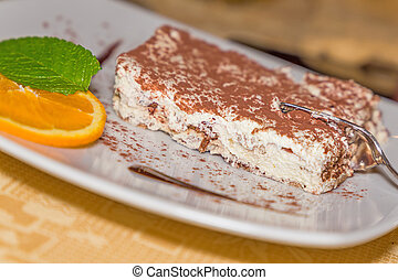 A portion of tiramisu cake