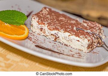 A portion of tiramisu cake
