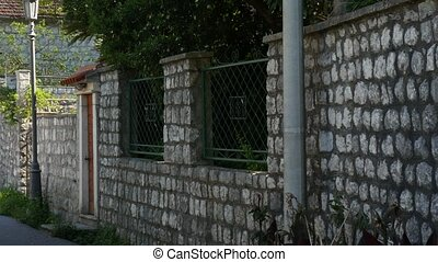 Stone fence in Montenegro. Villa near the sea.