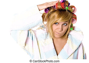 funny housewife with curlers - closeup portrait of funny...