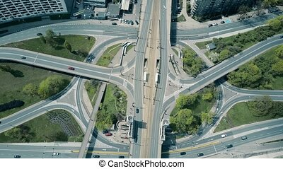 Aerial time lapse of big urban road junction, top down view....