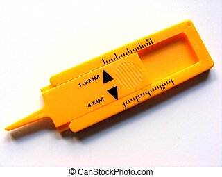 Tyre tread depth gauge - A plastic tool for measuring tyre...