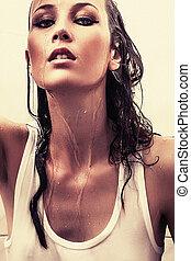 attractive wet brunette girl in shower