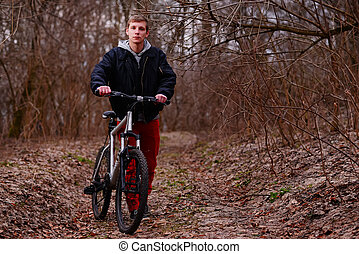 cyclist riding a mountain bike along the forest road