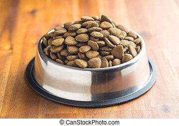 Dry kibble dog food. - Dry kibble dog food in metal bowl on...