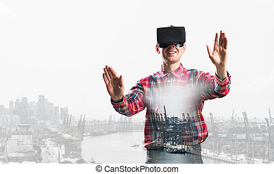 Guy wearing checked shirt and virtual mask stretching hands and trying to concentrate