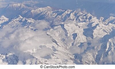 The Alps snowy peaks and clouds 4K video - The Alps snowy...