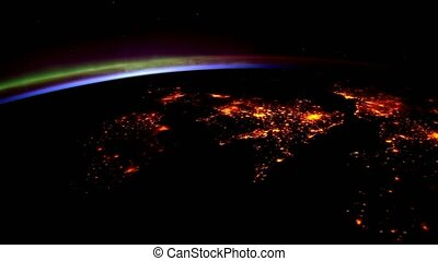 Planet Earth at night seen from the ISS. Elements of this...
