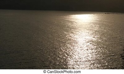 Sunny path of sunset on the water. Adriatic sea, Montenegro....