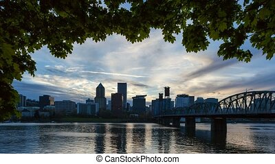 Time lapse of clouds over Portland OR skyline along...