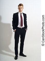 Stylish man in black suit - Young handsome man with red hair...