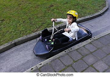 Young girl ride on Luge - Young girl ride on Luge in New...