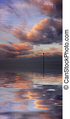 Beautiful water reflection of evocative cloudscape